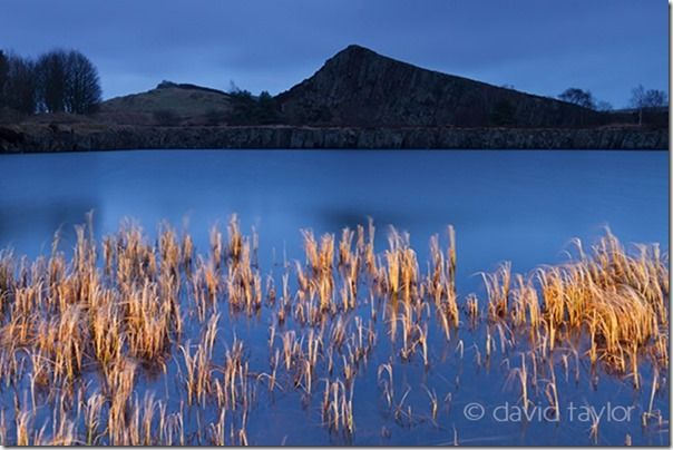 Reeds illuminated by torchlight in the lake below Cawfields Crag on Hadrian's Wall near the town of Haltwhistle, Northumberland, England, Painting with Light, Flash. Long exposure, torch, How to use a torch in your photography, flasggun, camera flash, LEDs, ambient light,