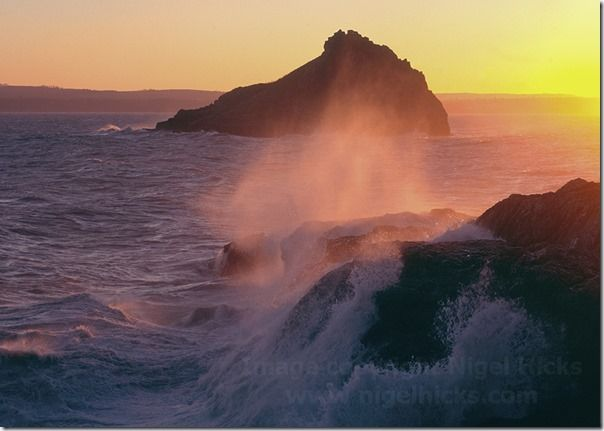 Spray sunlit by a setting winter sun, with Thatcher Rock in the background; Hope Nose, Torbay, Great Britain.,  calendars, How to publish a calendar, How to Publish a Photography Calendar, Higel Hicks Dorcet Light, Somerset Light, Devon Light,