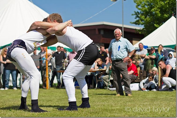 Young men engaged in 'Cumberland Wrestling' at the Northumberland County Show in Corbridge, England