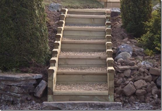 In my first garden I had to build a low retaining wall, with steps from the lower patio to the upper level of the garden. I did it with railway sleepers, ...