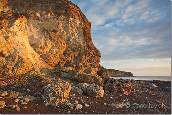 The magnesian limestone cliffs of  Hawthorn Hive near the town of Seaham. The area was heavily industrial until the 1980s and the remains of this industry is still to be found along this coastline, Lighting, Front light, back light, side light, side lighting, front lighting, back lighting, light, quality,