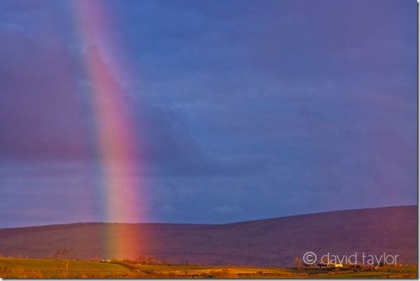 Late-evening rainbow above farmland in the Binevenagh area of the County Derry coast, Northern Ireland