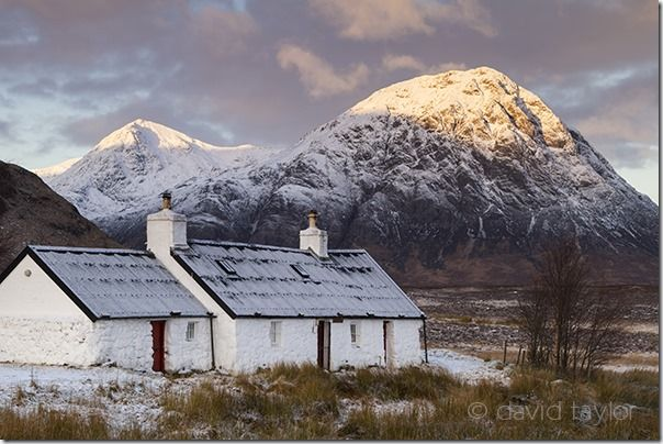 Blackrock Cottage at the foot of Meall a' Bhuird, Rannoch Moor with Buachaille Etive Mor (Stob Bearg) behind, Scottish Highlands, Scotland