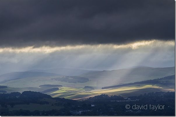 Stormy light over Melrose and the Tweed valley in the Scottish Borders, Scotland, hiking safety, hiking essentials, hiking safety tips, what to wear hiking, navigational aids, landmarks, Warm, cold, weather, climate, snow, heat, exhastion