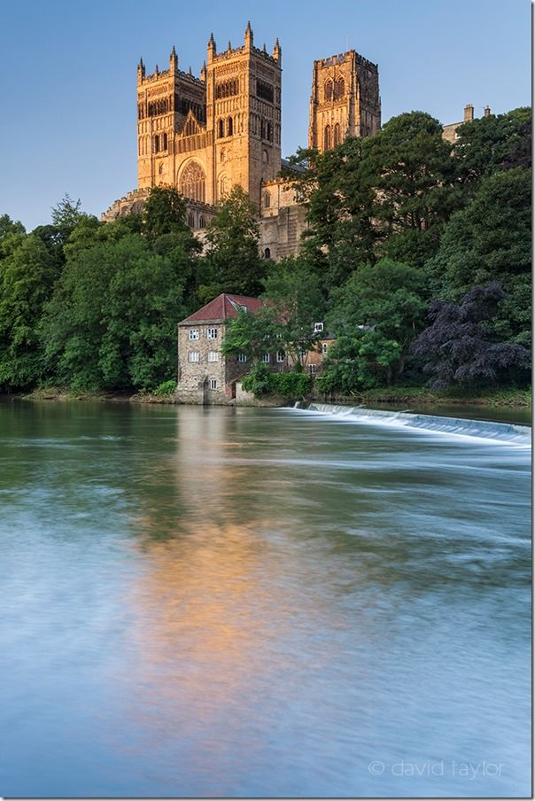 Durham Cathedral and the Museum of Archeology reflected in the water of the River Wear on a summer's evening