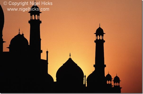 Part of the Taj Mahal silhouetted by the setting sun, Agra, India., sunset, sunsets, exposure, golden hour, camera lens, white balance, sun, light, dusk,