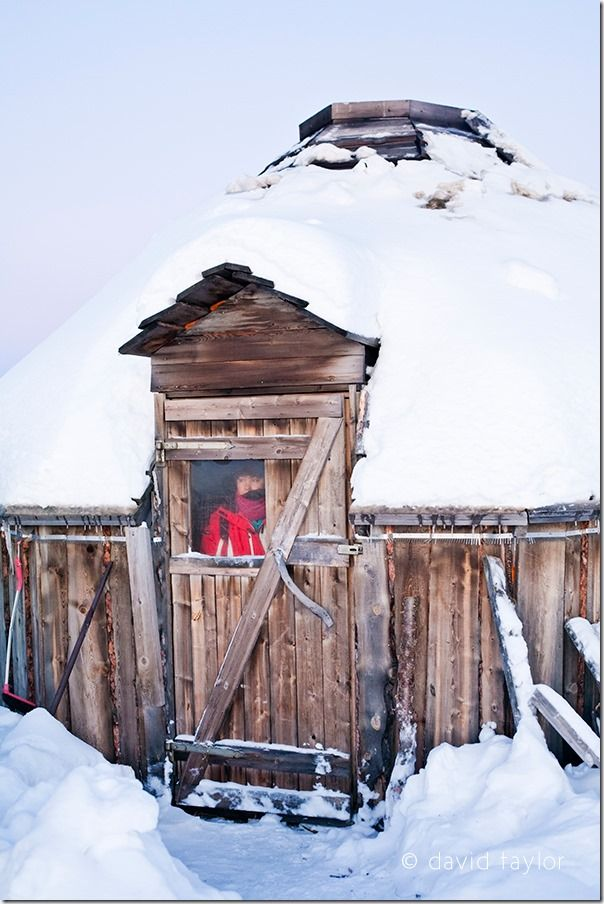 Woman looking out from a traditional Sami hut, Kiruna, Sweden, Solstice, Equinox, sun rise, sun set, dawn, dusk, landscape, photography, online photography courses, David Taylor, summer, winter,