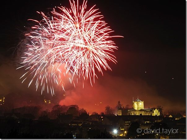 Firework display held in the Sele, a park in Hexham, with the floodlit Abbey and Gaol in the foreground, Northumberland, England, How to Photograph Fireworks, Night , photography, long exposure, ISO, rocket, sparkler, catherine wheel, Fireworks, party, Guy Forks night, 4th July, Thanksgiving