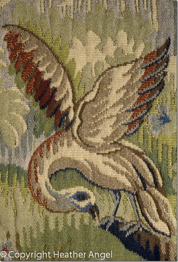 Bird on replica of C18 French tapestry by d' Aubusson