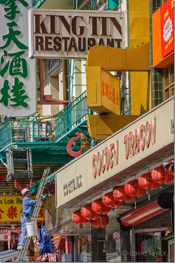 Repairing the neon signs above the streets of Chinatown, San Fra, Travel Photography Tips, Travel Photography, Holiday photography, online photography courses,