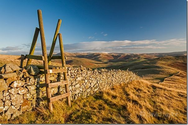 Style over a drystone wall leading to the summit of Wideopen Hill on the St. Cuthbert's Way long distance trail, Scottish Borders, Scotland
