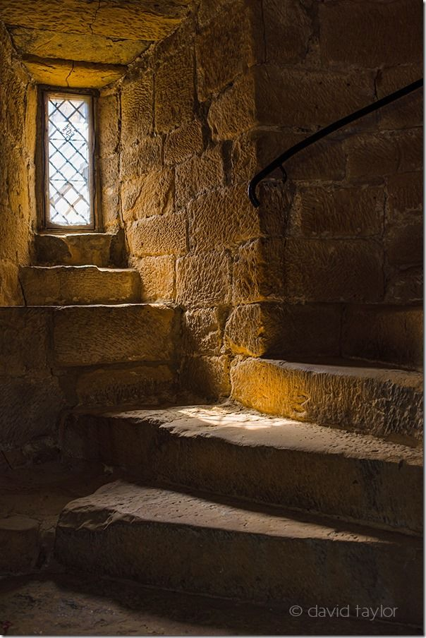 Dimly lit spiral staircase in Belsay Castle, Northumberland