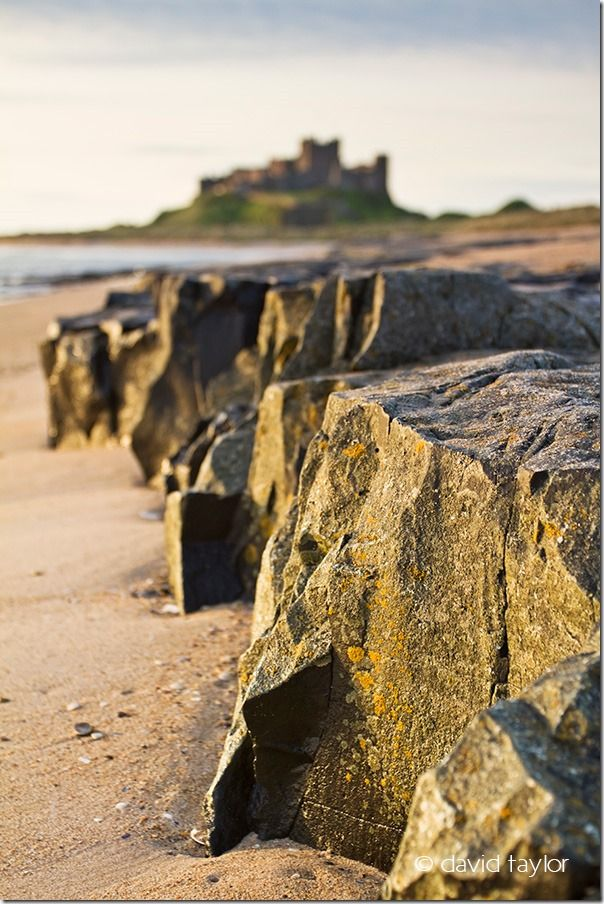 Rock shelf on Bambugh beach pointing toward Bamburgh Castle on the Northumberland coast, England, Restricting depth of field, depth of field, DOF, small depth of field, free monthly photography competition, Online Photography Courses, focusing