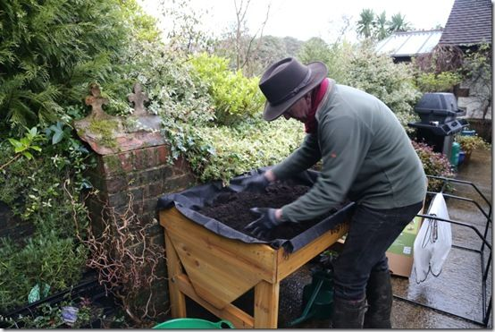 Breaking up and firming compost