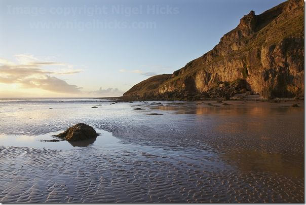 The cliffs of Brean Down, seen from Brean beach, Somerset, Great Britain.