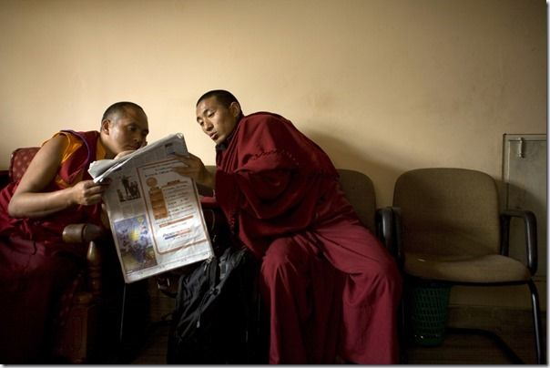 Buddhist monks reading a newspaper at the Vajra Vidya Institute for Buddhist studies in Sarnath, India
