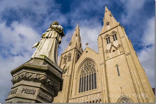 The facade of St Patrick's Roman Catholic cathedral in Armagh, County Armagh, Northern Ireland. The statue is the Archbishop William Crolly who laid the foundation stone in 1840