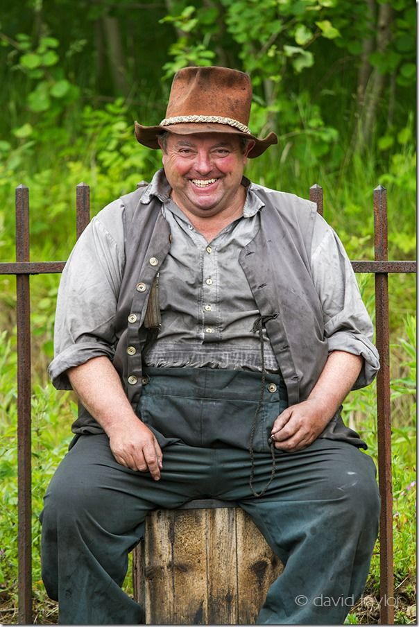 Actor at the Georgian section of Beamish open-air museum posing as a steam train engineer, County Durham, England, Professional, turning pro, photographer,
