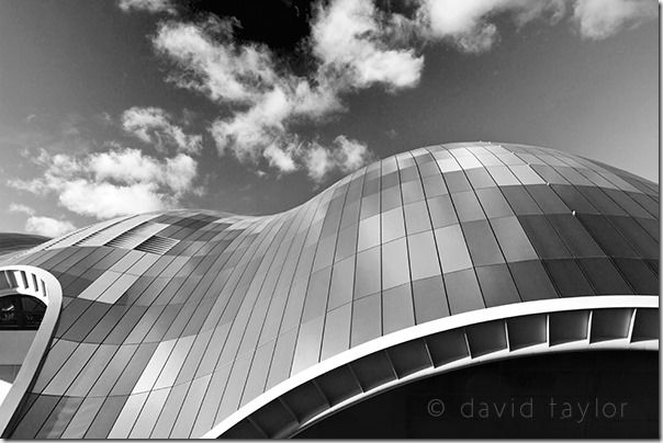 The glass roof of the Sage concert hall reflecting clouds in a blue sky, Gateshead, Tyne and Wear, England
