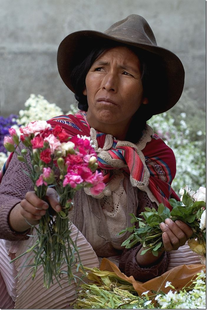 Bolivian woman selling flowers on the market of Sucre. South America