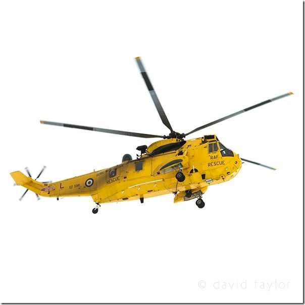 Westland Sea-King helicopter of the Royal Air Force Air-Sea Rescue service flying across an overcast sky, England, Shutter Speed, fast Shutter speed, freezing action, Hand held, Camera Shake, Panning,