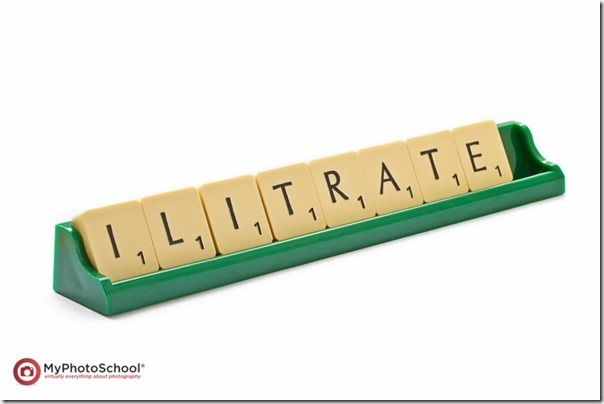 Scrabble tiles set to mispell the word illiterate