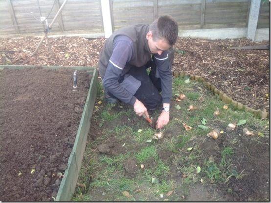 Jamie planting bulbsinwildlifemeadow