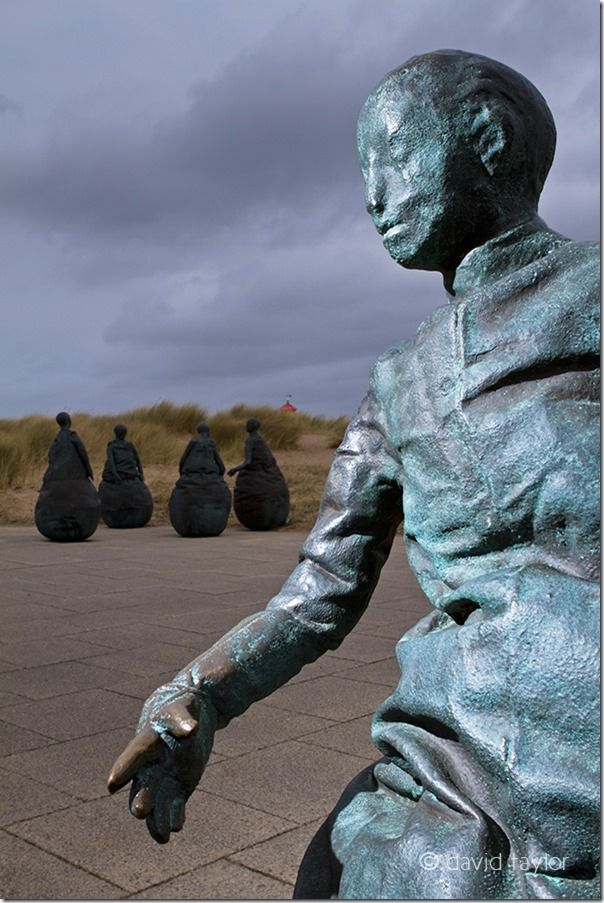Figures from the 'Conversation Piece' by the Spanish sculptor Juan Munoz at Littlehaven in South Shields, South Tyneside, England