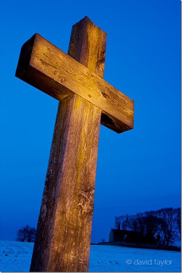 Wooden cross erected in 1927 to commemorate the battle of Heavenfield fought circa 633 between a Northumbrian army under Oswald of Bernicia and a Welsh army under Cadwallon ap Cadfan of Gwynedd, Northumberland, England, Painting with Light, Flash. Long exposure, torch, How to use a torch in your photography, flasggun, camera flash, LEDs, ambient light,